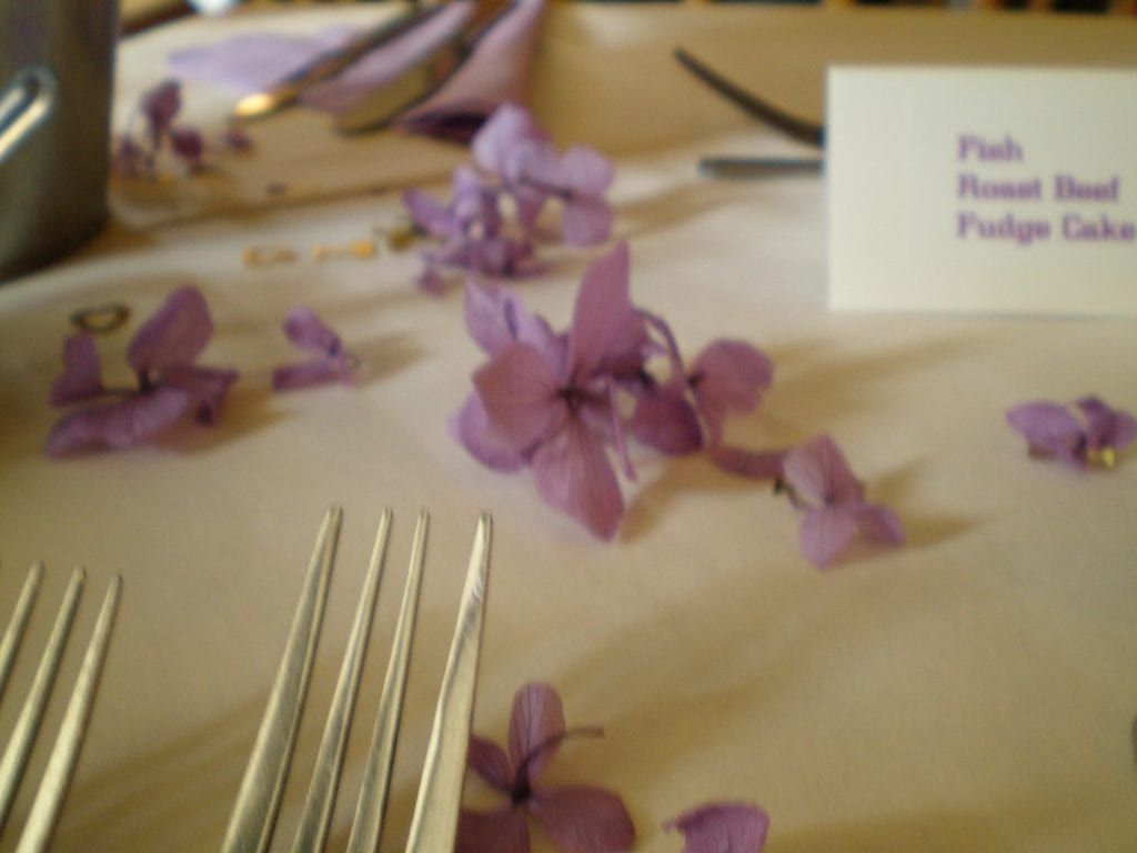 table wedding confetti petals hydrangea