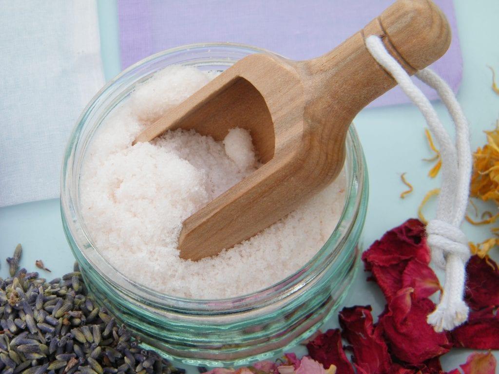 bath soak with scoop of salt