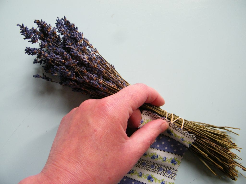 wrap fabric around dry lavender stems