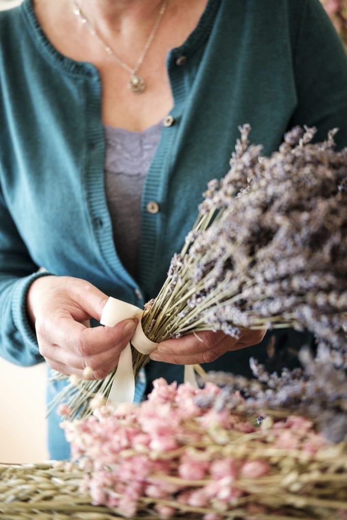 tying ribbon on dried flower bunch