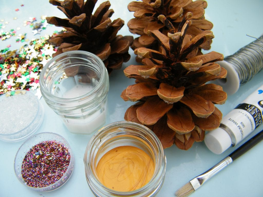 natural christmas tree decorations - pine cones and equipment