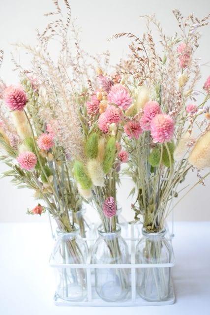pink dried flowers grasses milk bottles