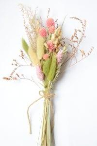 single dried grass clover posy